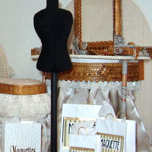 Miniature dress form, shopping bags, vanity